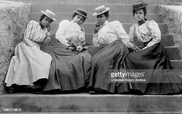 Four African American Women Sitting on Steps of Atlanta University, Atlanta, Georgia, USA, Thomas E Askew, WEB DuBois collection, 1900.
