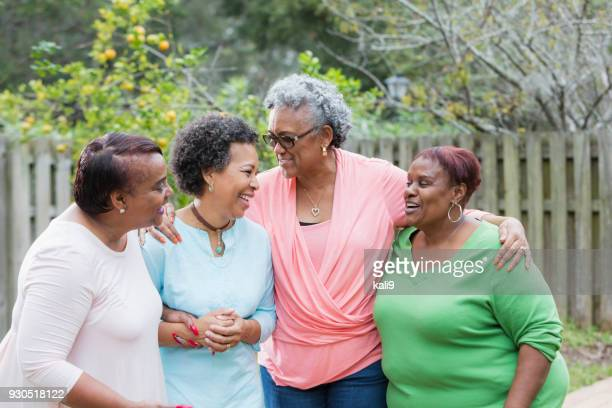 four african-american women standing outdoors together - family reunion stock pictures, royalty-free photos & images