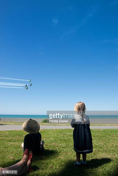 Four airplanes in an air display