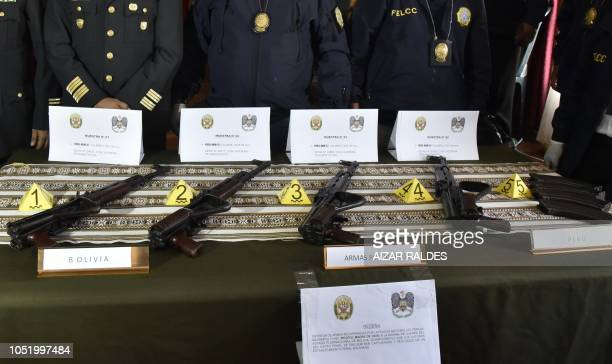 Four AKM47 are displayed after they were handed over to the Bolivian police from the Peruvian National Police in the border city of Desaguadero...