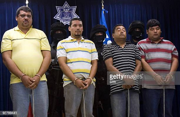 Four alleged members of the group Zetas of the drug trafficking gang El Cartel del Golfo are presented in a press conference following their arrest...
