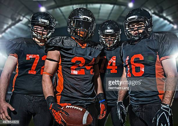four american football players, portrait - american football team stock pictures, royalty-free photos & images