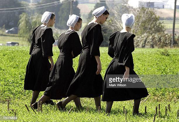 Four Amish girls walk to the home of one of the girls that was killed yesterday at the one room Amish schoolhouse shooting October 3 2006 in Nickel...