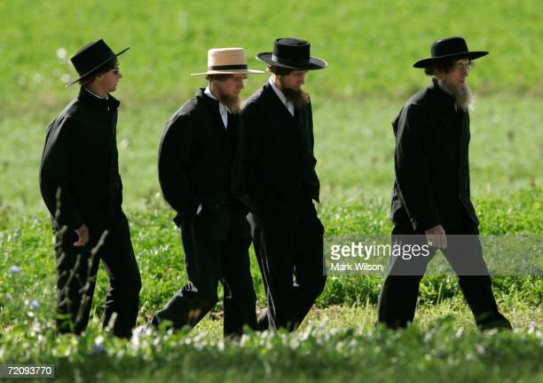 Four Amish men walk to a funeral for a victim of the Amish schoolhouse shootings October 5 2006 in Nickel Mines Pennsylvania On October 2 a milk...
