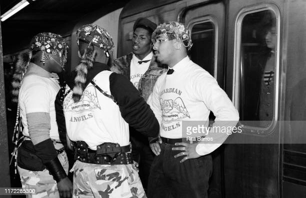 Four anti-crime activists from the Guardian Angels stand in a subway platform as they talk in front of the closed door of a subway car, New York, New...