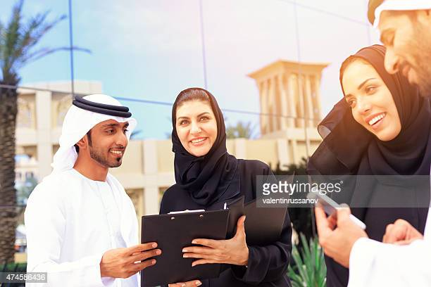 Four arab business people outside