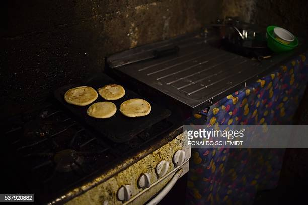 Four arepas for a family are pictured in the kitchen of a house in the poor neighbourhood of Gramoven Caracas on June 2 2016 Shortages of basic goods...