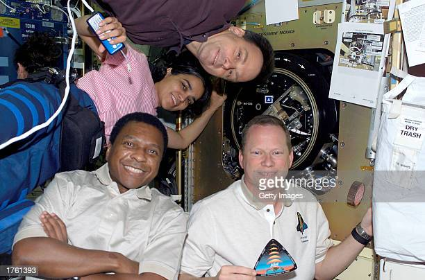 Four astronauts from the crew of the Space Shuttle Columbia mission STS107 Mission Specialist David M Brown Payload Commander Michael P Anderson...