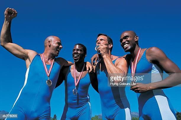 Four Athletes Celebrating Their Success
