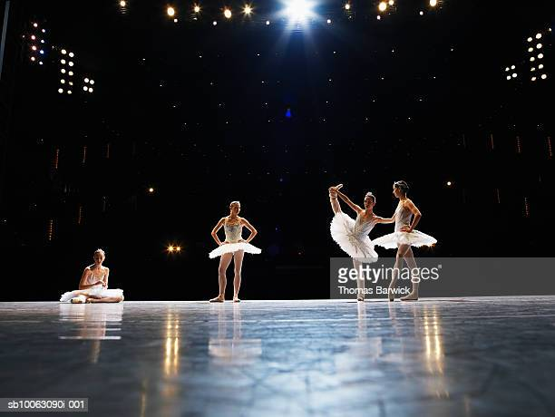 four ballerinas preparing for performance on stage - theatrical performance photos et images de collection