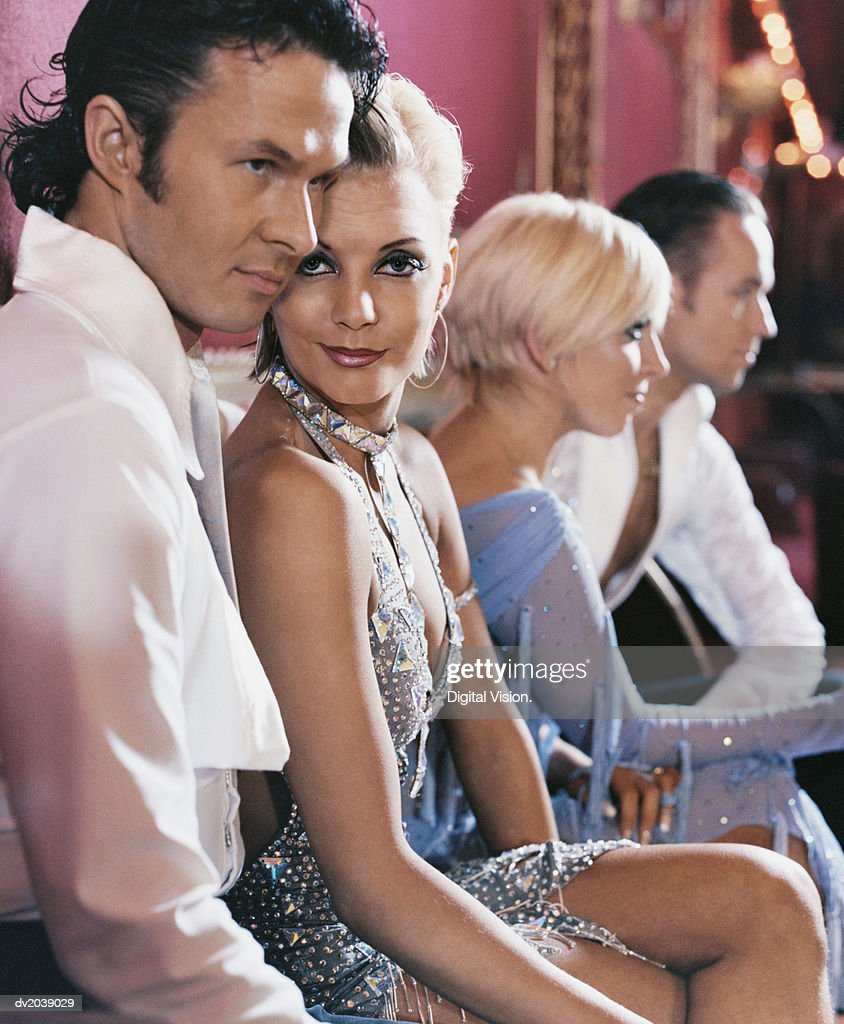 Four Ballroom Dancers Sitting : Stock Photo