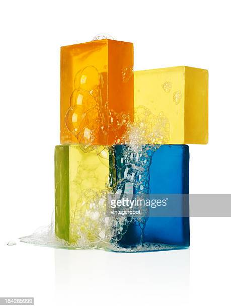 Four bars of sudsy soap on a white background