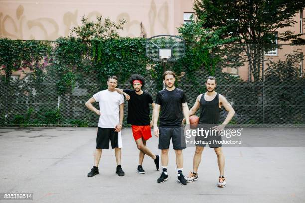 four basketball players together on their favourite court - four people stock pictures, royalty-free photos & images