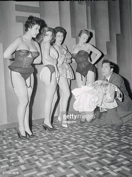 Four beauties from Italy display basic costumes for the striptease show Flash being presented at the Alhambra Theater in Paris as producer Ugo...