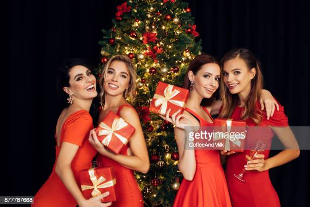 Four beautiful girls celebrate Christmas