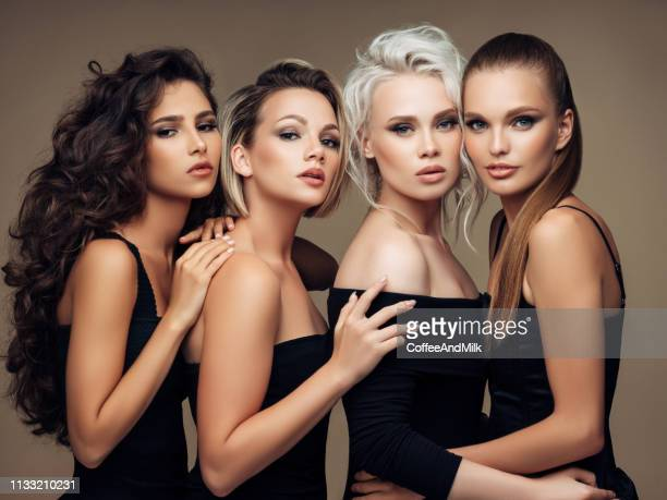 four beautiful girls with make-up and hairstyle - fashion model stock pictures, royalty-free photos & images