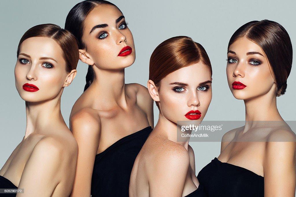 Cuatro hermosas chicas con maquillaje : Foto de stock