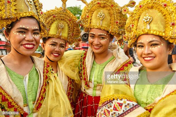 four beautiful woman wearing festival costume. - dinagyang festival stock photos and pictures