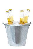 Four beer bottles in ice in a metal bucket