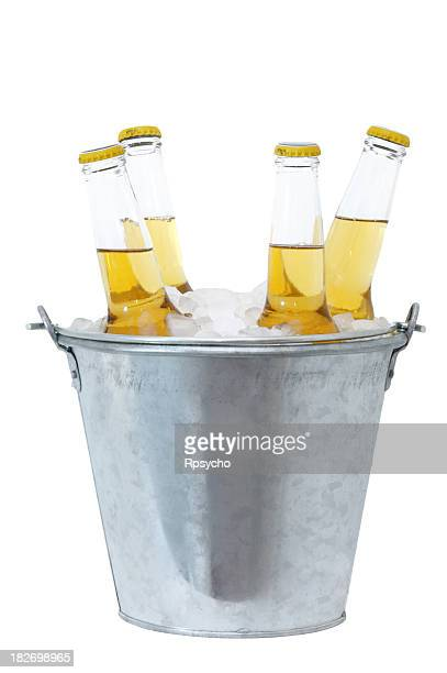 Four beer bottles in ice in a metal bucket
