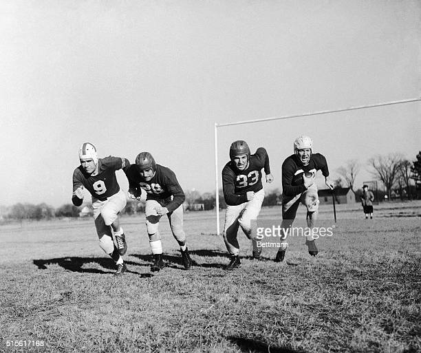 Four big names in the National Football League charge downfield here in preparation for the Jan 4 battle between the AllStars and Chicago's champion...