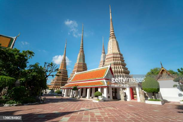 four big pagoda in wat phra chettuphon wimon mangkhalaram rajwaramahawiha temple of the reclining buddha or who pho with clear sky in bangkok, thailand. - wat pho stock pictures, royalty-free photos & images