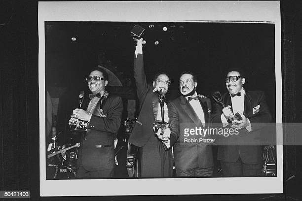 Four black members of the vocal group The Four Tops incl Levi Stubbs Duke Fakir Obie Benson Lawrence Payten holding their awards as they pose...