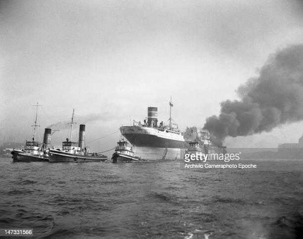 Four boats dragging the oiler tank Luise while on fire Giudecca Venice 1951