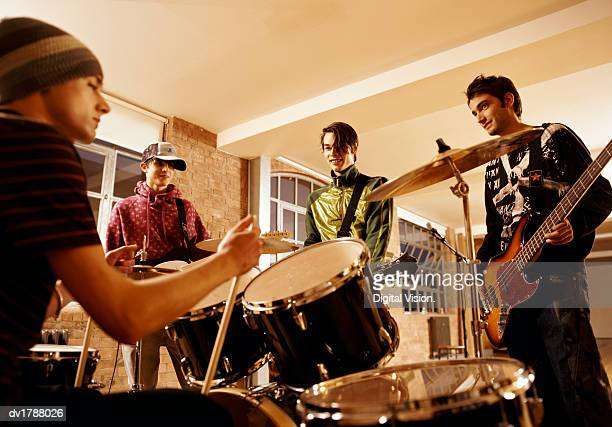 Four Boys in a Music Band Practising