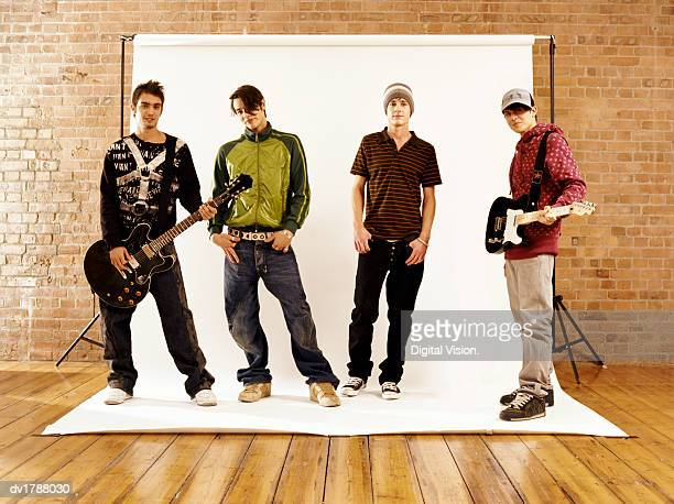 Four Boys in a Music Band Striking a Pose