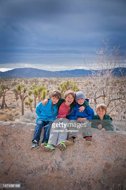 four boys on desert camping trip, winter