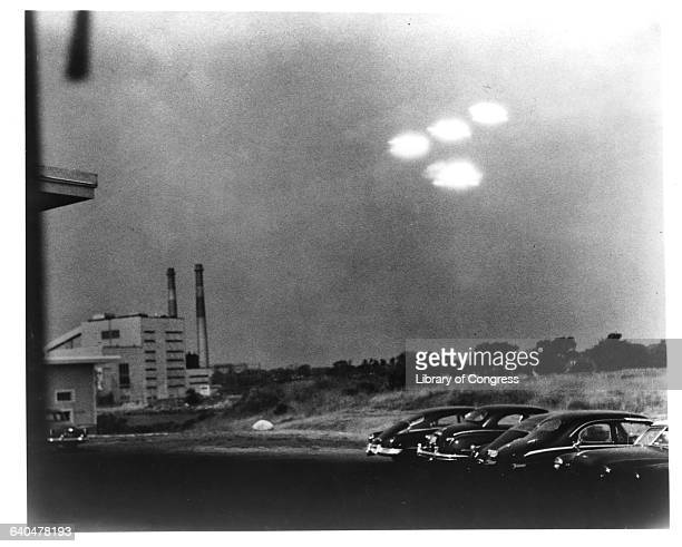 Four brightly glowing unidentified objects appeared in the sky at 935 am on July 15 1952 over a parking lot