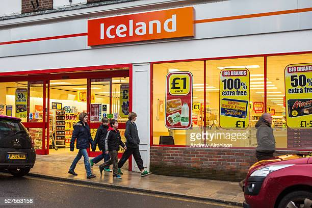 Four British children walk past a large and bright Iceland supermarket in Blandford Forum United Kingdom Iceland is a British supermarket chain in...