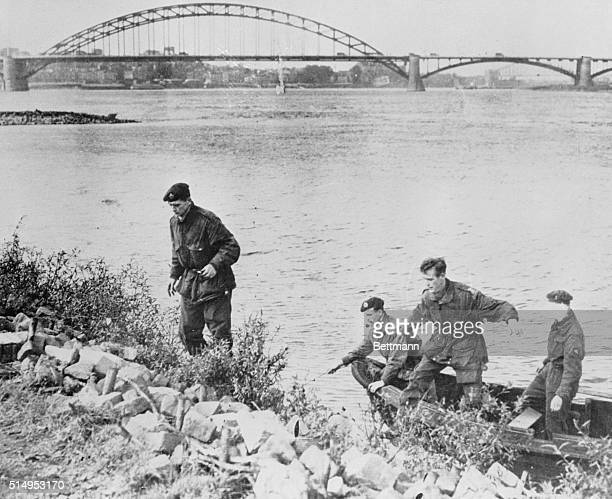 Four British paratroopers who were captured on the last outpost on Arnhem Bridge and taken captives to Germany are shown as they later escaped...