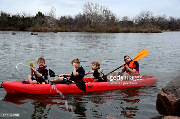 four brothers kayaking - lynn pleasant stock pictures, royalty-free photos & images