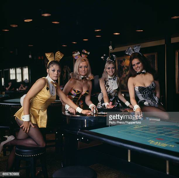 Four Bunny Girl croupiers pose together at the Playboy Club in Park Lane London wearing both the newly introduced and old costumes at the club in...