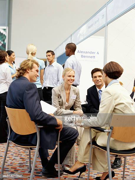 four business executives discussing at an exhibition