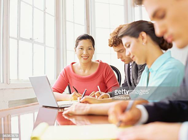 four business executives sitting around a table in an office