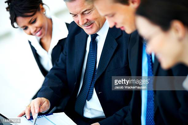 Four business people in a meeting