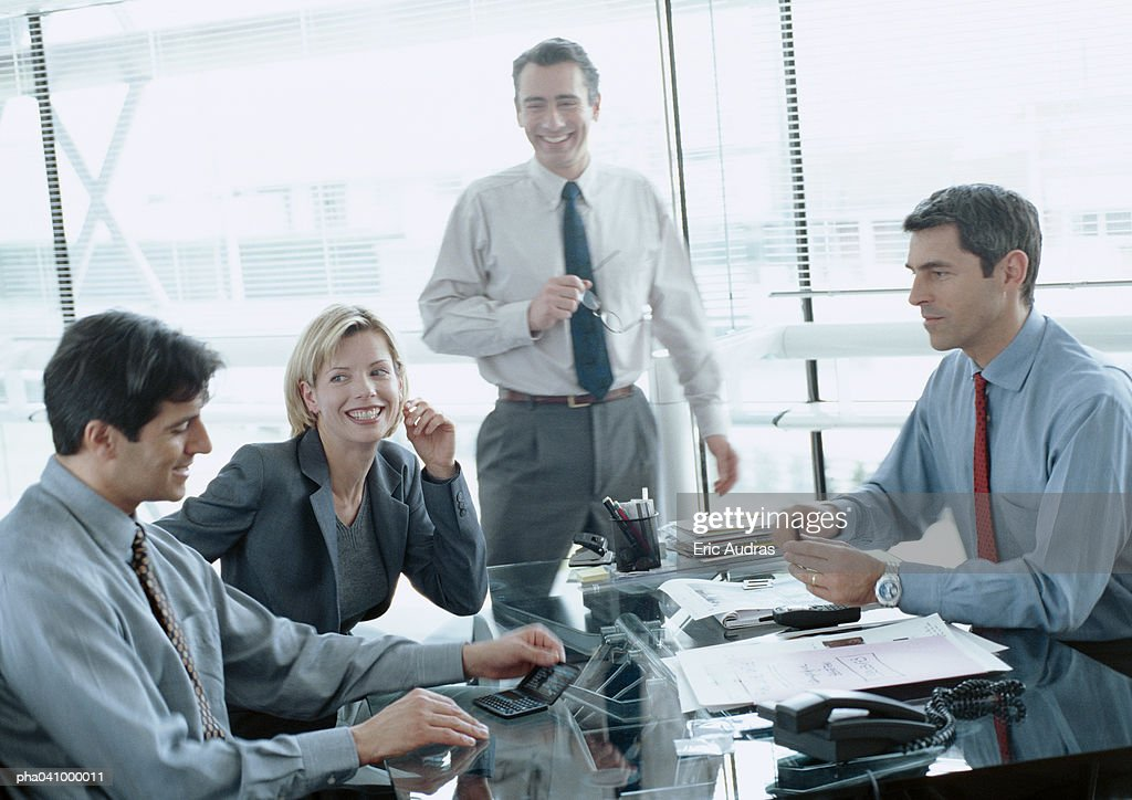 Four business people in conference room, blurred : Stockfoto