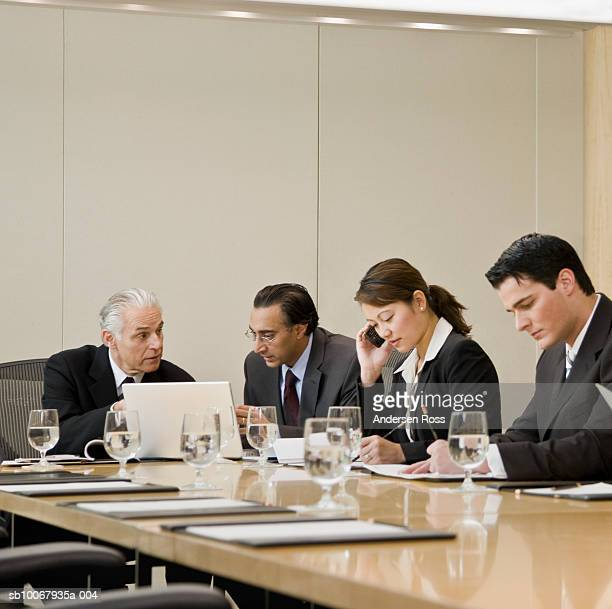 Four business people in conference room