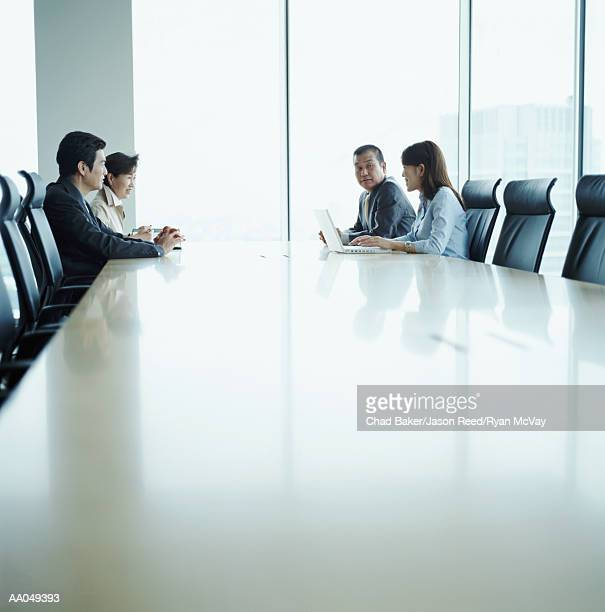 Four business people meeting in conference room