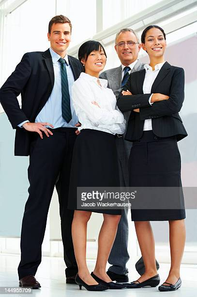 four business people standing together - four people stock pictures, royalty-free photos & images
