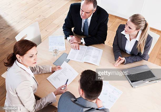 Four businesspeople having a meeting in conference room