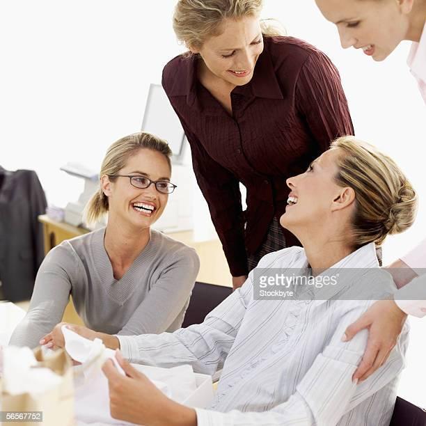 four businesswomen talking in an office