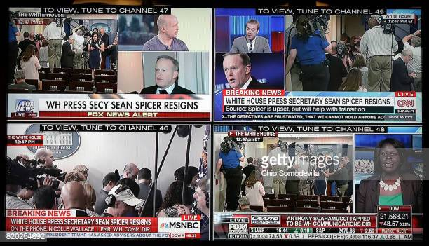 Four cable news networks are simultaneously displayed on a television in the White House press office after news that Press Secretary Sean Spicer has...