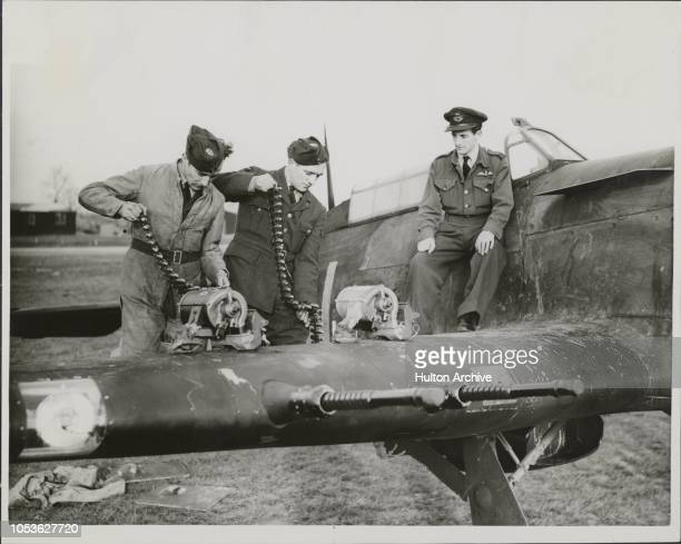 Four cannon Hurricane 15th Dec 1941 Loading up the shells on the four cannon Hurricane After its excellent record in the Battle of Britain the Hawker...