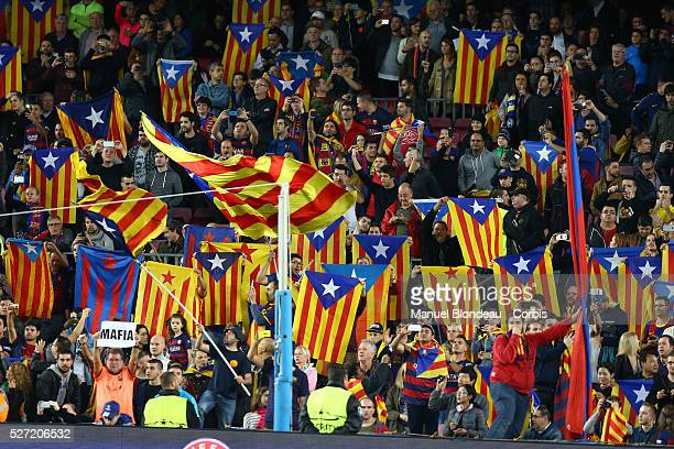 Four Catalan independance groups are handing out 30000 Estelada to the crowd nearby the Camp Nou Stadium to protest against UEFA who have twice fined...
