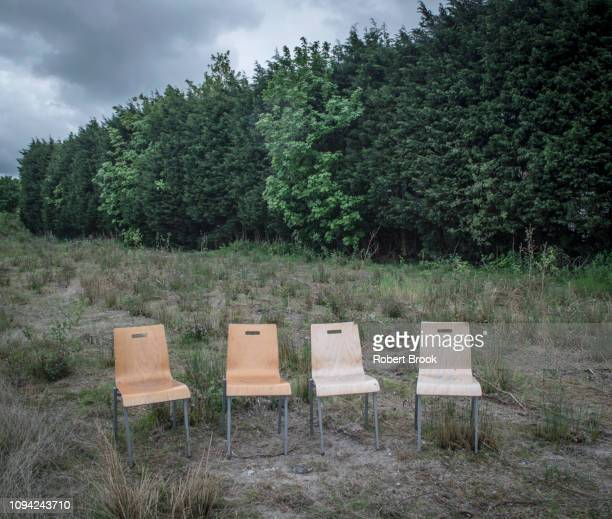 Four chairs in wasteland