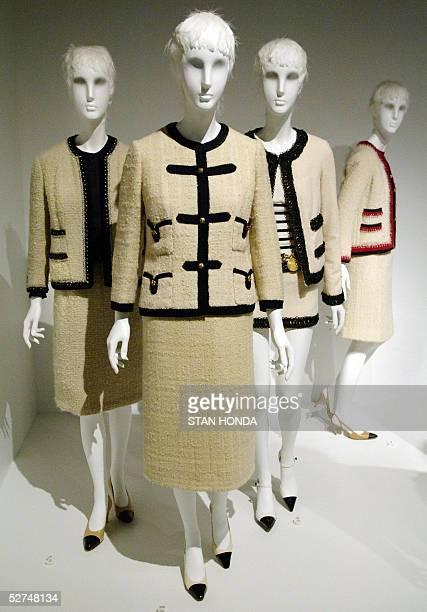 Four Chanel suits designed by Gabrielle Chanel from 1958 and 196061 and by Karl Lagerfeld from 198687 and 1994 are seen at a press preview of Chanel...